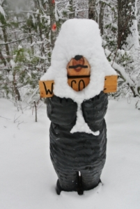 Chainsaw Bear Welcome Sign in the Snow